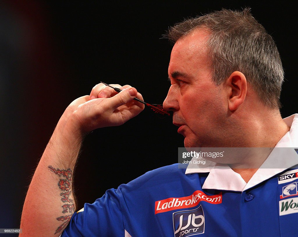 Phil Taylor of England in action in his game against Adrian Lewis of England during the Quarter Finals of the 2010 Ladbrokes.com World Darts Championships at Alexandra Palace on January 1, 2010 in London, England.