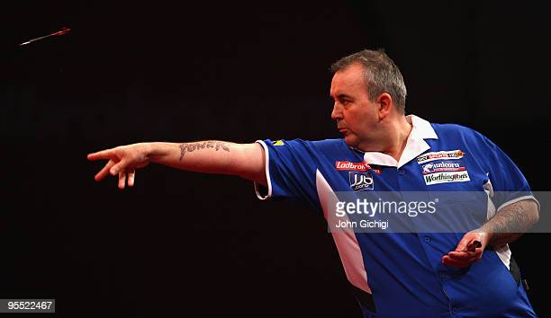 Phil Taylor of England in action in his game against Adrian Lewis of England during the Quarter Finals of the 2010 Ladbrokescom World Darts...
