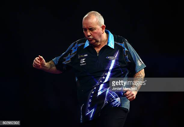 Phil Taylor of England looks dejected in his third round match against Jelle Klaasen of the Netherlands on Day Twelve of the 2016 William Hill PDC...