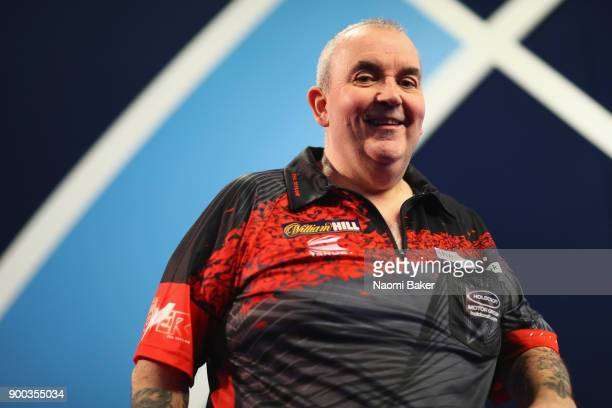 Phil Taylor of England poses for a photograph as he walks onto the stage prior to the Final against Rob Cross of England on Day Fifteen at the 2018...