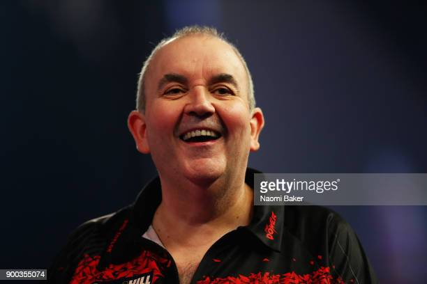 Phil Taylor of England reacts after winning a leg during the PDC World Darts Championship final against Rob Cross of England on Day Fifteen at the...