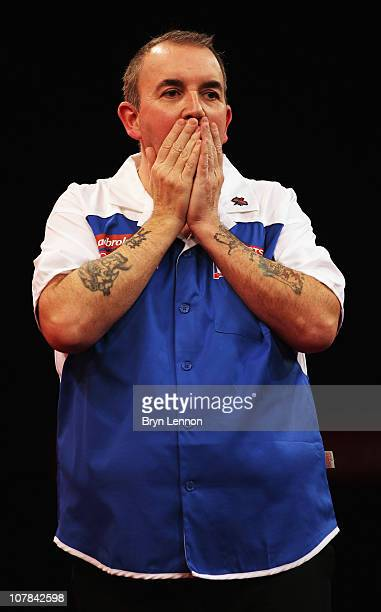 Phil Taylor of England reacts during his match against Mark Webster of Wales during the quarter finals of the 2011 Ladbrokescom World Darts...