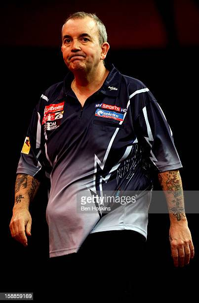 Phil Taylor of England reacts during the final of the 2013 Ladbrokescom World Darts Championship against Michael van Gerwen of the Netherlands at the...