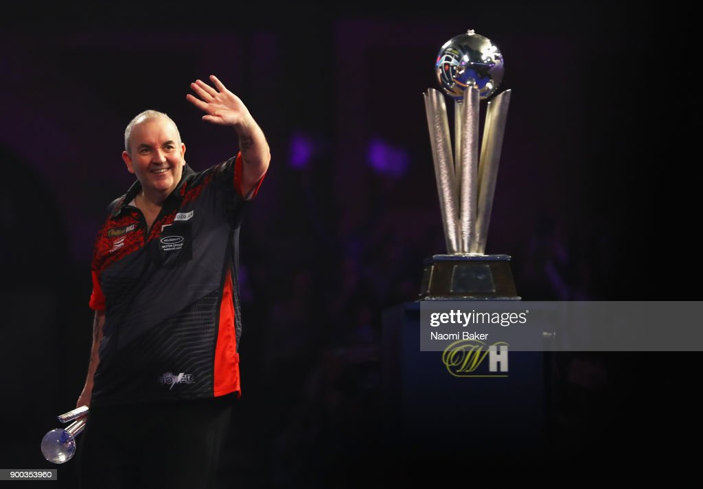 Phil Taylor of England shows appreciation to the crowd after he loses the PDC World Darts Championship final against Rob Cross of England on Day Fifteen at the 2018 William Hill PDC World Darts Championships at Alexandra Palace on January 1, 2018 in London, England.