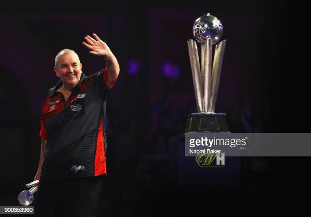 Phil Taylor of England shows appreciation to the crowd after he loses the PDC World Darts Championship final against Rob Cross of England on Day...