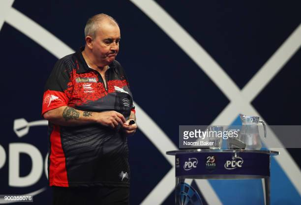 Phil Taylor of England shows dissapointment during the PDC World Darts Championship final against Rob Cross of England on Day Fifteen at the 2018...