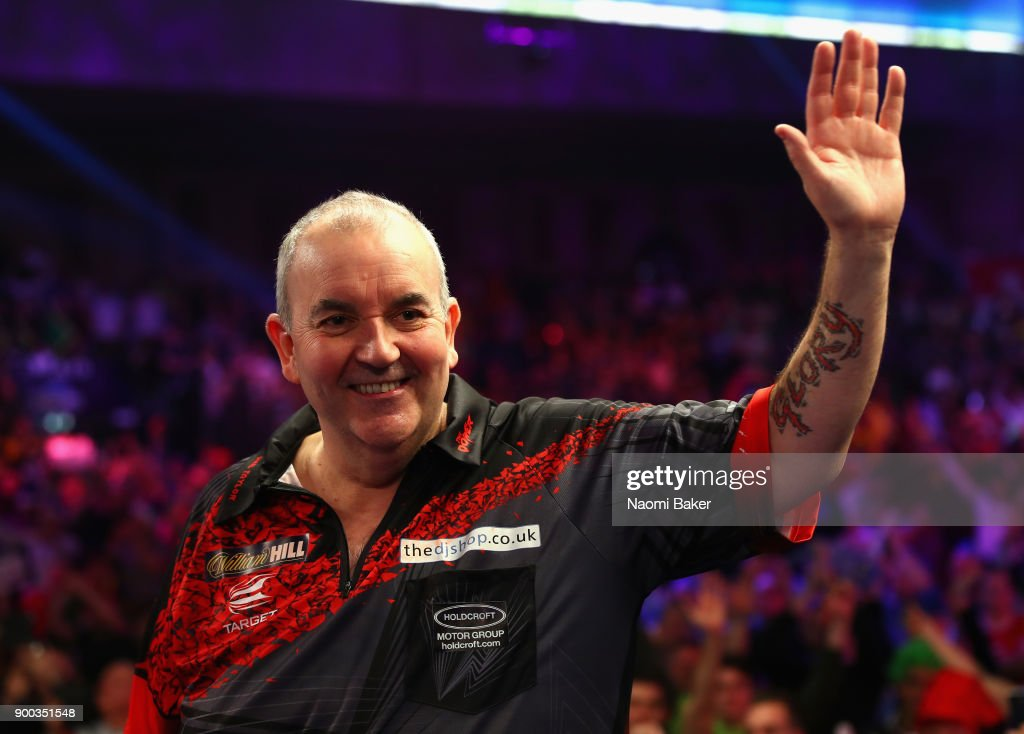 Phil Taylor of England shows his appreciation to the crowd after he loses the PDC World Darts Championship final against Rob Cross of England on Day Fifteen at the 2018 William Hill PDC World Darts Championships at Alexandra Palace on January 1, 2018 in London, England.