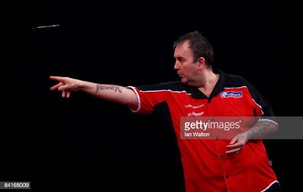 Phil Taylor of England throws a dart during his Final match against Raymond Van Barneveld of the Netherlands during the 2009 Ladbrokes.com PDC World...
