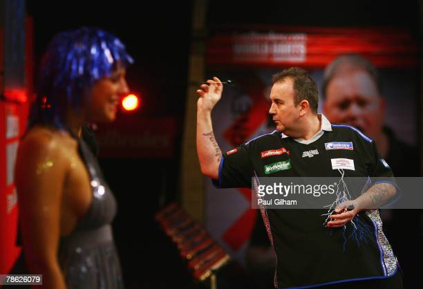 Phil Taylor of England throws a dart during the second round match between Phil Taylor of England and Mark Walsh of England during the 2008...