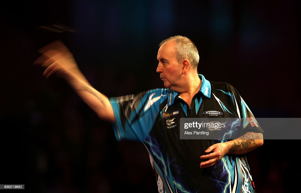 Phil Taylor of England throws during his first round match against David Platt of England during Day Four of the 2017 William Hill PDC World Darts Championships at Alexandra Palace on December 18, 2016 in London, England.