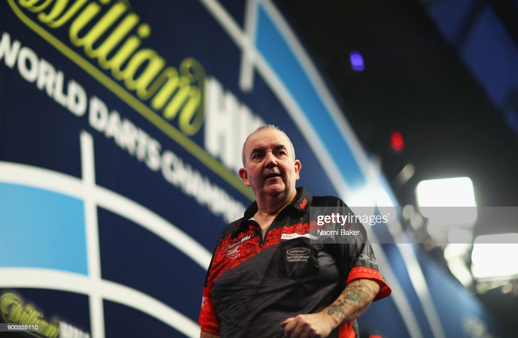 Phil Taylor of England walks off the stage after a set during the PDC World Darts Championship final against Rob Cross of England on Day Fifteen at the 2018 William Hill PDC World Darts Championships at Alexandra Palace on January 1, 2018 in London, England.
