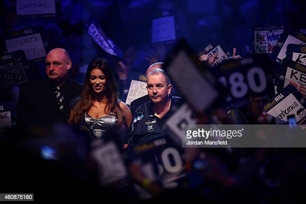 Phil Taylor of England walks to the stage ahead of his second round match against Mark Webster of Wales on Day Eight of the William Hill PDC World...