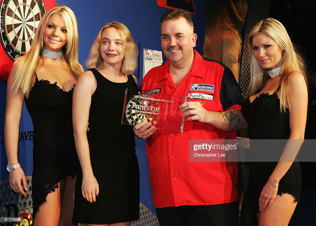 Phil Taylor poses with his prize after Andy Fordham conceded due to illness during the Showdown match at The Circus Tavern November 21, 2004 in Purfleet, England.