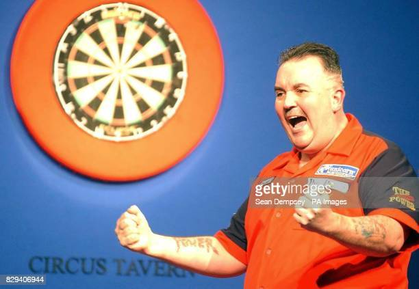 Phil 'The Power' Taylor celebrates winning a frame against Andy Fordham at Circus Tavern Purfleet