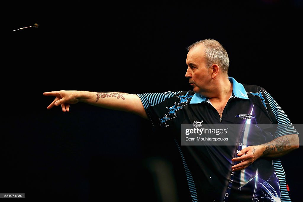 Phil 'The Power' Taylor of England plays a shot in his match against Michael van Gerwen of the Netherlands during the Darts Betway Premier League Night 15 at Rotterdam Ahoy on May 12, 2016 in Rotterdam, .