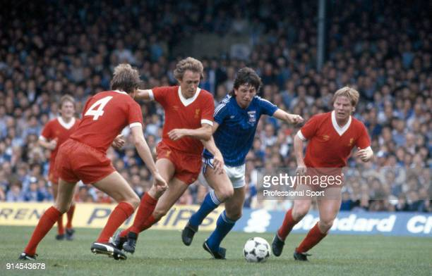 Phil Thompson , Phil Neal and Sammy Lee , all of Liverpool, crowd out Paul Mariner of Ipswich Town during a Football League Division One match at...
