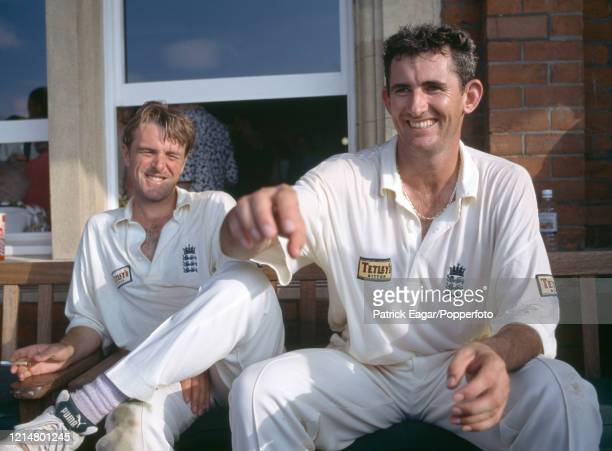 Phil Tufnell and Andy Caddick of England relax after England won the 6th Test match between England and Australia by 19 runs at The Oval, London,...