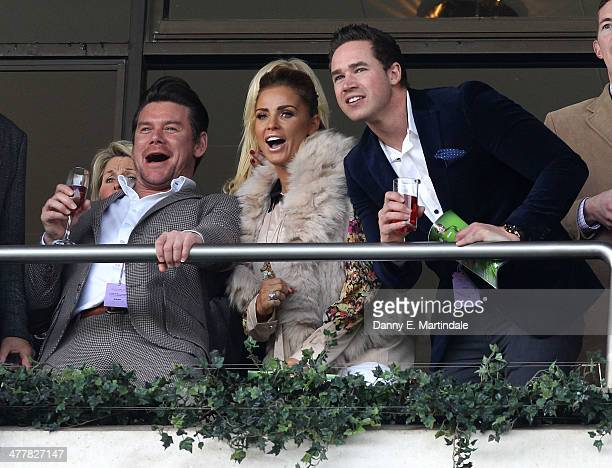 Phil Turner Katie Price and husband Kieran Hayler watch the second race on day 1 of The Cheltenham Festical at Cheltenham Racecourse on March 11 2014...