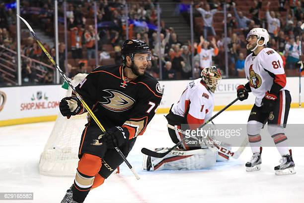 Phil Varone and Mike Condon of the Ottawa Senators look on after Joseph Cramarossa of the Anaheim Ducks scores a goal during the first period of a...