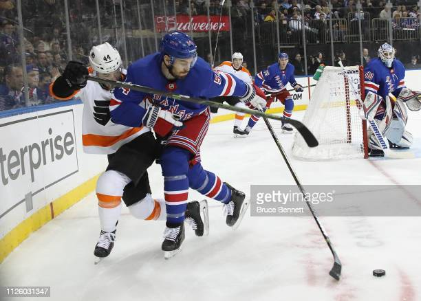 Phil Varone of the Philadelphia Flyers and Adam McQuaid of the New York Rangers battle at Madison Square Garden on January 29 2019 in New York City...