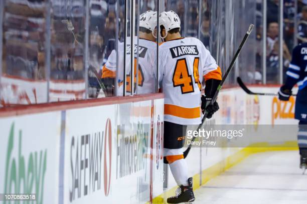 Phil Varone of the Philadelphia Flyers heads into the penalty box after receiving a minor penalty during third period action against the Winnipeg...