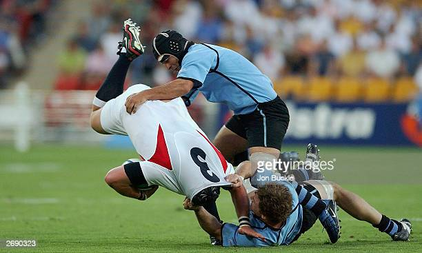 Phil Vickery of England is tackled by Nicolas Brignoni of Uruguay during the Rugby World Cup Pool C match between England and Uruguay at Suncorp...