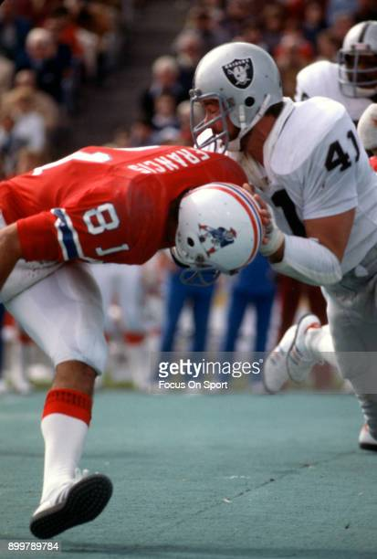 Phil Villapiano of the Oakland Raiders in action against Russ Francis of the New England Patriots during an NFL Football game October 3 1976 at...
