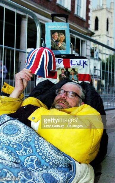 Phil Ward from London beds down for the night opposite the Guildhall Windsor in preparation for the wedding between the Prince of Wales and Camilla...