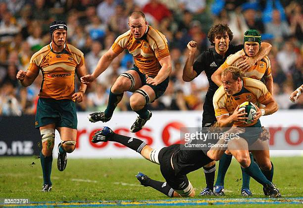 Phil Waugh of the Wallabies is tackled during the Bledisloe Cup match between the Australian Wallabies and the New Zealand All Blacks at Hong Kong...