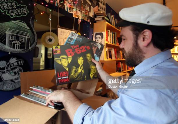 Phil Wilcox music and literary guide and store manager at Tres Gatos Bookstore in the Jamaica Plain neighborhood of Boston sorts through newly...