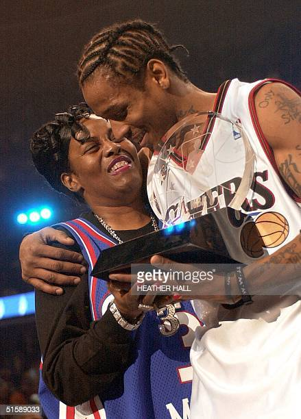 Philadelphia 76er' guard Allen Iverson hugs his mother Ann after winning the MVP trophey for his performance in the 2001 NBA AllStar Game 11 February...
