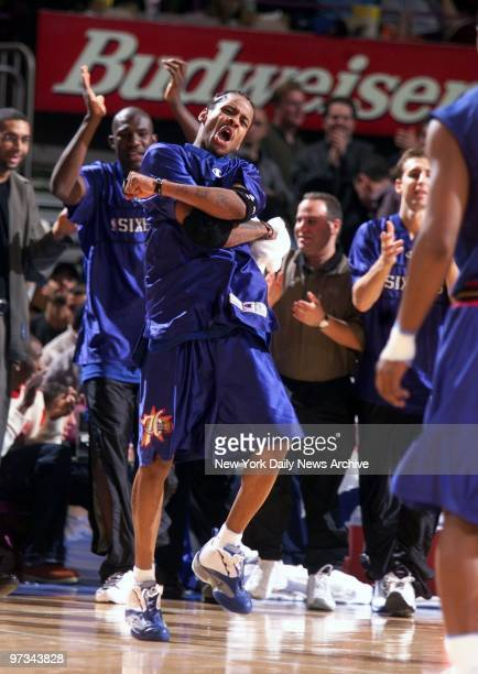 Philadelphia 76ers' Allen Iverson bustsamove as he dances near his team's bench in the closing minutes of their game against the New York Knicks The...