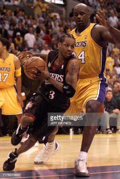 Philadelphia 76ers Allen Iverson drives by Los Angeles Lakers Shaquille O'Neal during the second half of the NBA Finals Game 1 at the Staples Center...