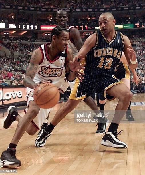 Philadelphia 76ers' Allen Iverson drives on Indiana Pacers' Mark Jackson during the NBA second round playoff 19 May 2000 at the First Union Center...