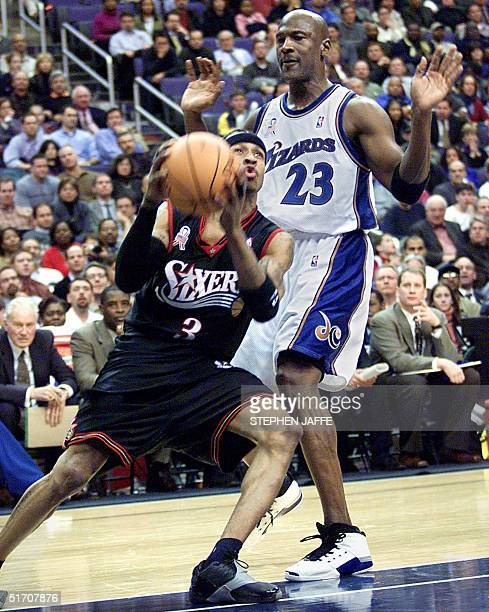 Philadelphia 76ers' Allen Iverson goes around Washington Wizards' Michael Jordan during the fourth quarter of action 22 January 2002 at the MCI...