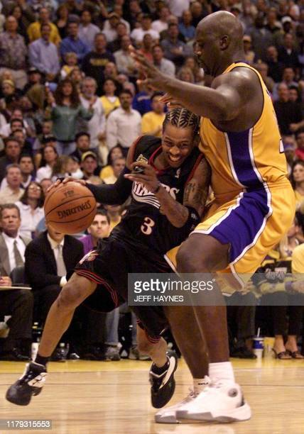 Philadelphia 76ers Allen Iverson is blocked by Los Angeles Lakers Shaquille O'Neal during the second half of the NBA Finals Game 1 against the Los...
