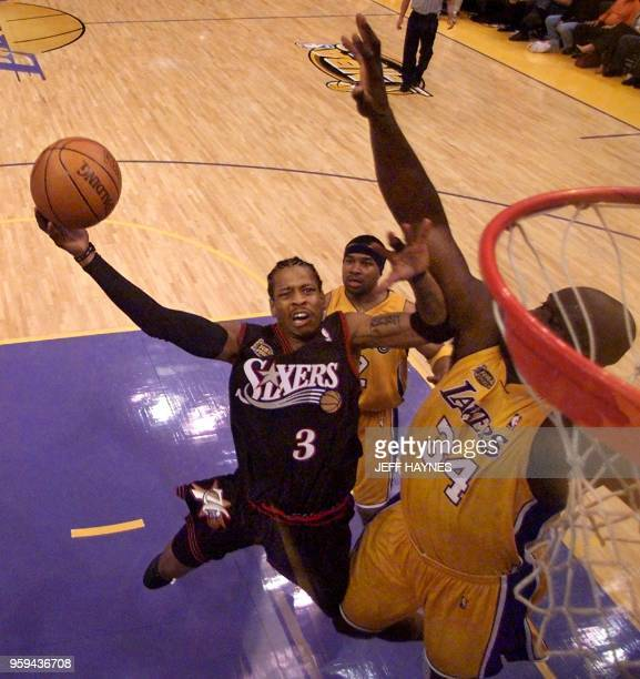 Philadelphia 76ers Allen Iverson jumps to score as Los Angeles Lakers Shaquille O'Neal tries to block during the second half of the NBA Finals Game 1...