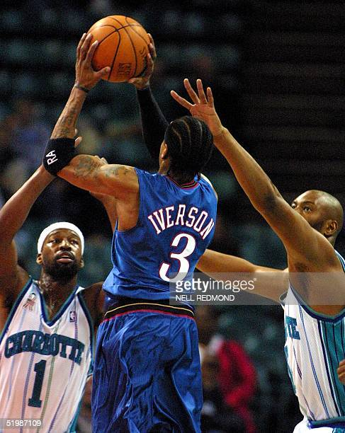 Philadelphia 76ers Allen Iverson shoots over Charlotte Hornets Baron Davis and Elden Campbell in the first half at the Charlotte Coliseum in...