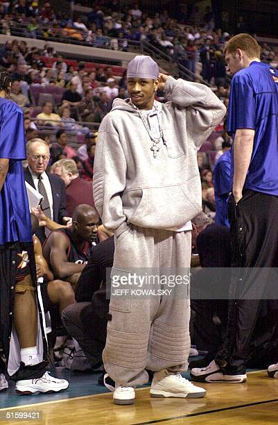 Philadelphia 76ers Allen Iverson stands in street clothes during a time out during the first quarter against the Detroit Pistons at the Palace of...