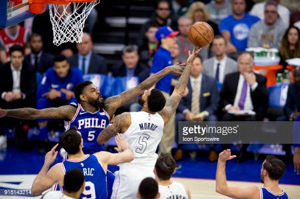 Philadelphia 76ers Center Amir Johnson defends a shot by Washington Wizards Forward Markieff Morris in the second half during the game between the...