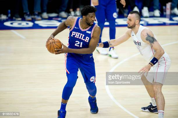 Philadelphia 76ers Center Joel Embiid shields the ball from Washington Wizards Center Marcin Gortat in the second half during the game between the...