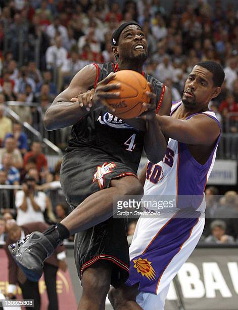 Philadelphia 76ers Chris Webber left is fouled by Kurt Thomas of Phoenix Suns during a NBA Live Tour friendly basketball match between Philadelphia...