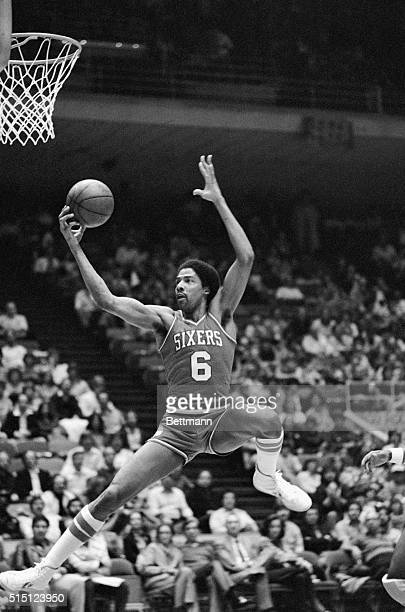 "Philadelphia 76ers ""Dr. J."" Julius Erving flies through the air grabbing a court long pass to score two points early in the first period in the 11/21..."