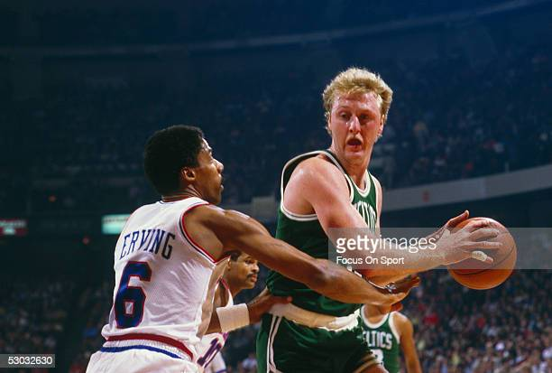 Philadelphia 76ers' forward Julius Erving defends against Boston Celtics' Larry Bird during a game at The Spectrum circa 1990 in Philadelphia...