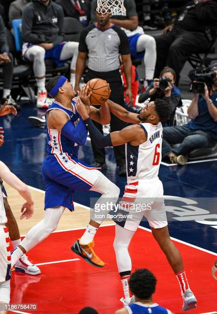 Philadelphia 76ers forward Tobias Harris drives to the basket against Washington Wizards guard Troy Brown Jr on December 5 2019 at the Capital One...