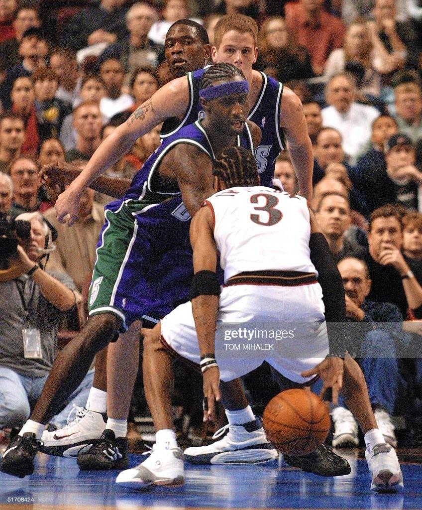 d7153bb87e8 Philadelphia 76ers guard Allen Iverson dribbles the ball behind his ...