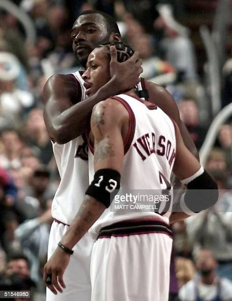 Philadelphia 76ers' guard Allen Iverson gets a hug from 76ers' guard Aaron McKie in the final minute of game three of the NBA Eastern Conference...