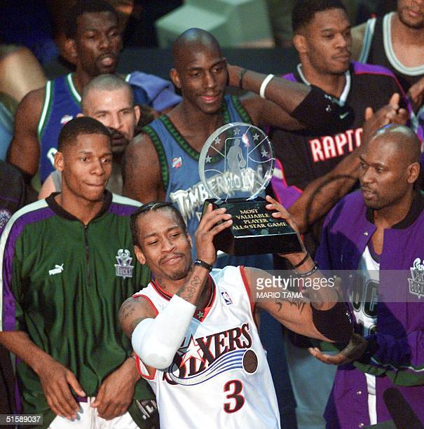 Philadelphia 76ers' guard Allen Iverson stands with his fellow NBA AllStars and holds his MVP trophy for his performance in the 2001 NBA AllStar Game...