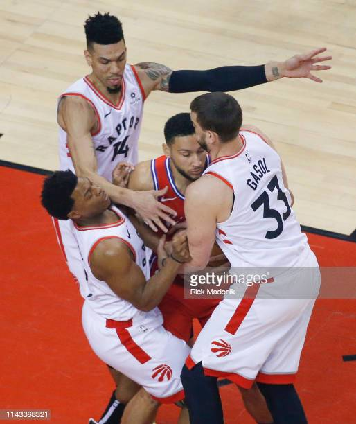 Philadelphia 76ers guard Ben Simmons is swarmed on defence by Toronto Raptors guard Kyle Lowry Toronto Raptors guard Danny Green and Toronto Raptors...