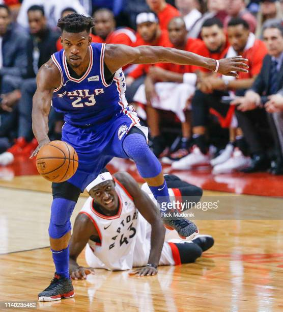 Philadelphia 76ers guard Jimmy Butler comes up with the loose ball after deflecting it out of the control of Toronto Raptors forward Pascal Siakam ....